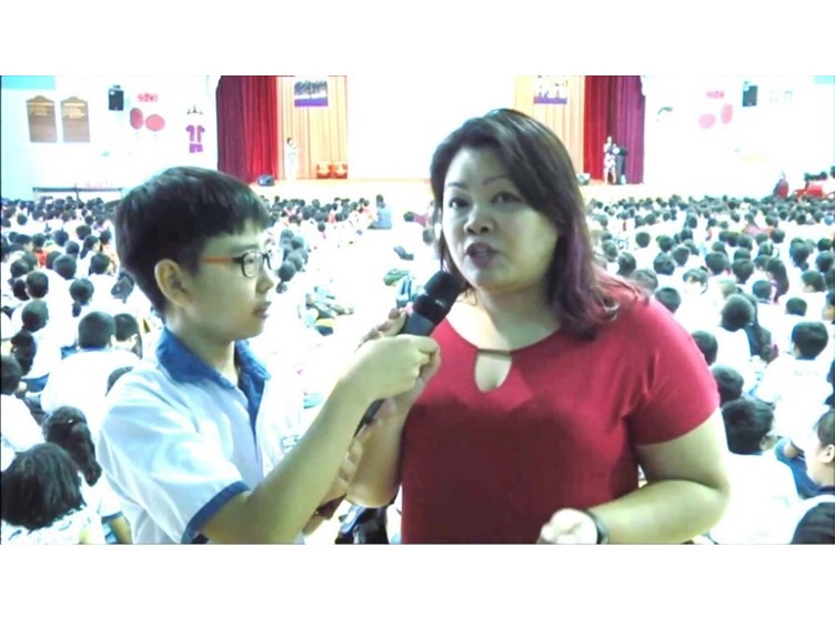 QNN journalists reporting school event 1.jpg