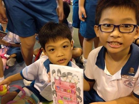 P1 pupil showing appreciation to his P3 buddy by making him a Thank You card.jpg