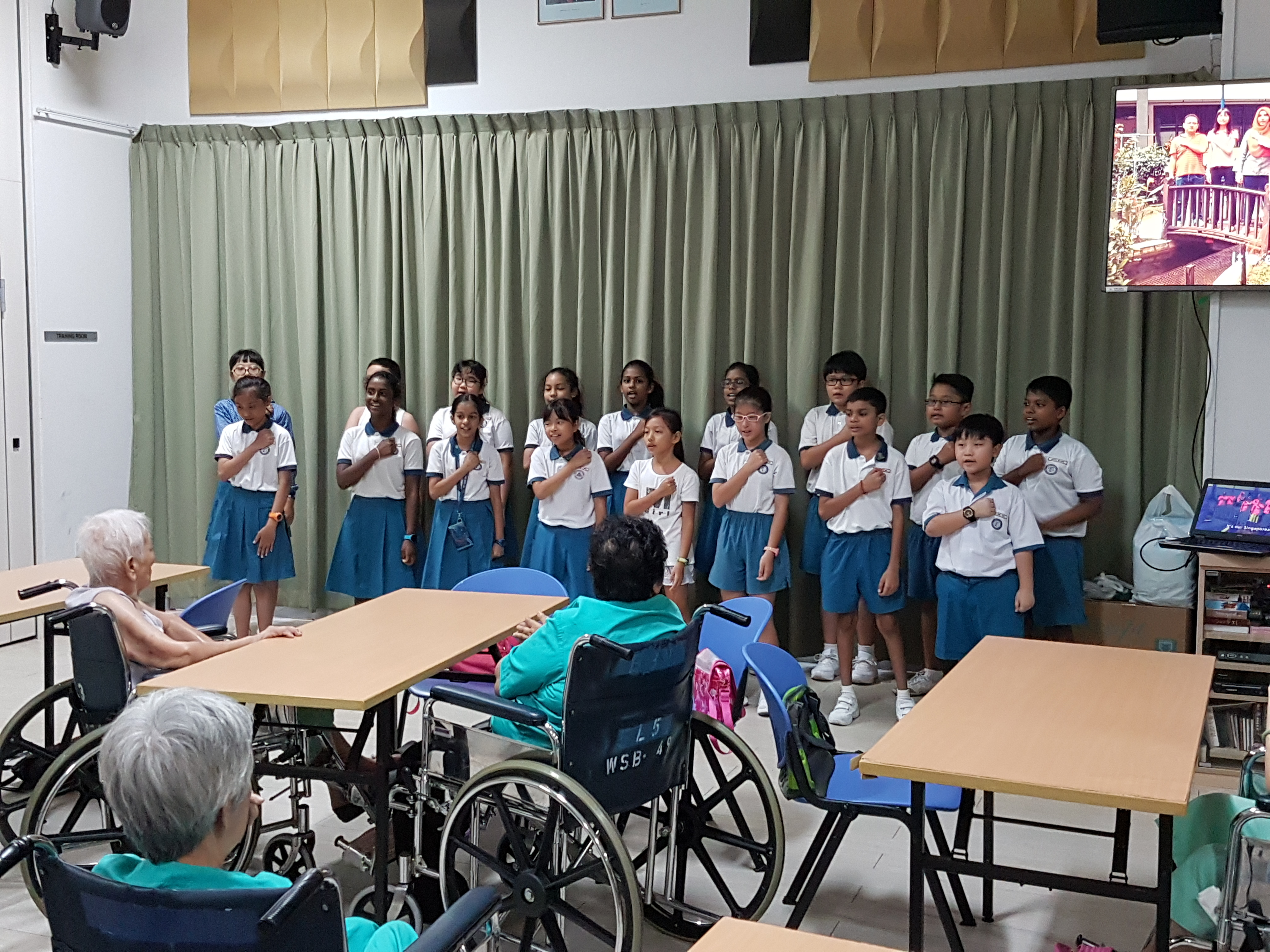 Pupils performing during their visit to Renci Hospital.jpg