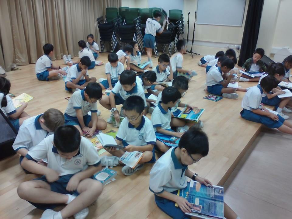 EL Dept_Pupils immersing in reading during NLB mass borrowing.jpeg